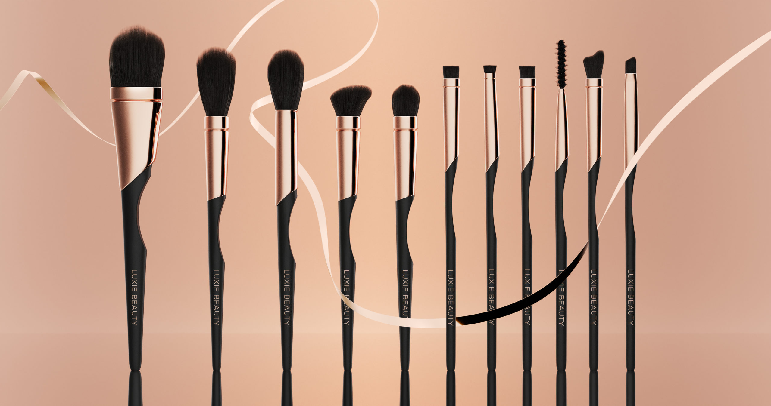 Wenbo Zhao-Luxary Makeup Brushes-Luxie Beauty-flying golden ribon and warm color background